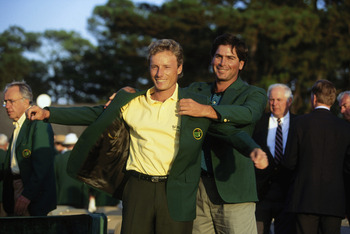 AUGUSTA,GA - APRIL 11: Bernhard Langer of Germany is presented with the green jacket by Fred Couples of USA after the final round of the Masters, held at The Augusta National Golf Club on April 11, 1993 in Augusta, Georgia.  (Photo by David Cannon/Getty I