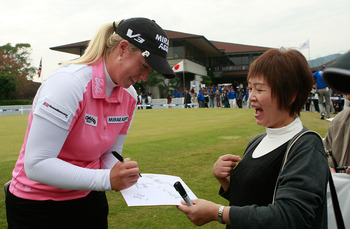 SHIMA, JAPAN - NOVEMBER 07:  Brittany Lincicome of United States signs her autograph for fans during the final round of the Mizuno Classic at Kintetsu Kashikojima Country Club on November 7, 2010 in Shima, Japan.  (Photo by Chung Sung-Jun/Getty Images)
