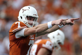 AUSTIN, TX - SEPTEMBER 25:  Quarterback Garrett Gilbert #7 of the Texas Longhorns during the first quarter against the UCLA Bruins at Darrell K Royal-Texas Memorial Stadium on September 25, 2010 in Austin, Texas.  (Photo by Ronald Martinez/Getty Images)
