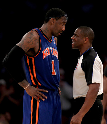 LOS ANGELES, CA - JANUARY 9:  Referee Tony Brown restrains Amar'e Stoudemire #1 of the New York Knicks after Stoudemire was knocked down on a flagrant foul in the game against the Los Angeles Lakers at Staples Center on January 9, 2011 in Los Angeles, Cal