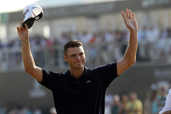 DUBAI, UNITED ARAB EMIRATES - NOVEMBER 28:  Martin Kaymer of Germany celebrates securing the Race to Dubai Trophy on the 18th green during the final round of the Dubai World Championship on the Earth Course at Jumeirah Golf Estates on November 28, 2010 in
