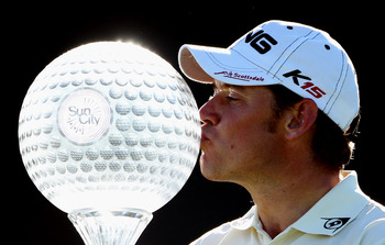 SUN CITY, SOUTH AFRICA - DECEMBER 05:  Lee Westwood of England poses with the trophy after winning the 2010 Nedbank Golf Challenge at the Gary Player Country Club Course  on December 5, 2010 in Sun City, South Africa.  (Photo by Warren Little/Getty Images