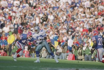 31 Jan 1993:  Defensive back Matt Darby (left) of the Buffalo Bills charges against wide receiver Michael Irvin of the Dallas Cowboys during the Super Bowl XVII game at the Rose Bowl in Pasadena, California. The Cowboys defeated the Bills 52-17. Mandatory