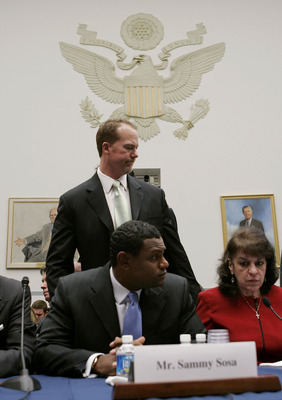WASHINGTON - MARCH 17:  Former St. Louis Cardinal Mark McGwire passes behind Baltimore Oriole Sammy Sosa during a House Committe session investigating Major League Baseball's effort to eradicate steroid use on Capital Hill March 17, 2005 in Washington, DC