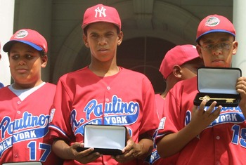 393788 05: (FILE PHOTO) Danny Almonte (C) and other members of the Rolando Paulino All-Stars Bronx Little League baseball team hold their keys to the city during a ceremony honoring the team August 28, 2001 in New York City. Dominican Republic officials s