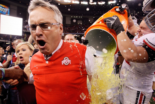 NEW ORLEANS, LA - JANUARY 04:  Head coach Jim Tressel of the Ohio State Buckeyes screams as Gatorade is dumped on him after the Buckeyes 31-26 victory against the Arkansas Razorbacks during the Allstate Sugar Bowl at the Louisiana Superdome on January 4,