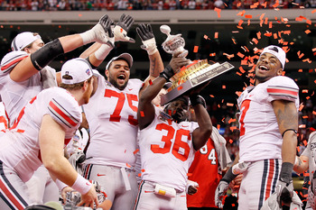 NEW ORLEANS, LA - JANUARY 04:  Brian Rolle #36 of the Ohio State Buckeyes holds the trophy as the Buckeyes celebrate their 31-26 victory against the Arkansas Razorbacks during the Allstate Sugar Bowl at the Louisiana Superdome on January 4, 2011 in New Or