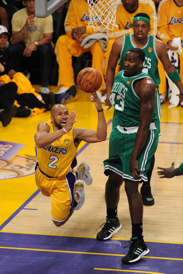 LOS ANGELES, CA - JUNE 15:  Derek Fisher #2 of the Los Angeles Lakers passes the ball past Kendrick Perkins #43 of the Boston Celtics in Game Six of the 2010 NBA Finals at Staples Center on June 15, 2010 in Los Angeles, California.  NOTE TO USER: User exp