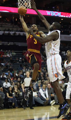 CHARLOTTE, NC - DECEMBER 29:  Ramon Sessions #3 of the Cleveland Cavaliers dunks the ball on Nazr Mohammed #13 of the Charlotte Bobcats during their game at Time Warner Cable Arena on December 29, 2010 in Charlotte, North Carolina. NOTE TO USER: User expr