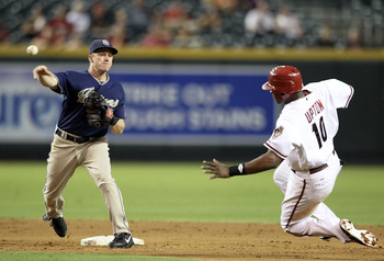 PHOENIX - AUGUST 30:  Infielder David Eckstein #22 of the San Diego Padres throws over the sliding Justin Upton #10 of the Arizona Diamondbacks to complete a double play during the fifth inning of the Major League Baseball game at Chase Field on August 30