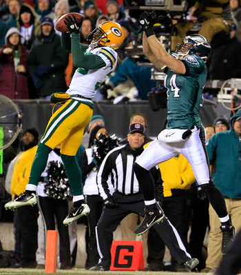 PHILADELPHIA, PA - JANUARY 09:  Tramon Williams #38 of the Green Bay Packers intercepts the pass intended for Riley Cooper #14 of the Philadelphia Eagles late in the fourth quarter during the 2011 NFC wild card playoff game at Lincoln Financial Field on J