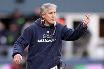 SEATTLE, WA - JANUARY 08:  Head coach Pete Carroll of the Seattle Seahawks reacts in the first half as the Seahawks take on the New Orleans Saints during the 2011 NFC wild-card playoff game at Qwest Field on January 8, 2011 in Seattle, Washington.  (Photo
