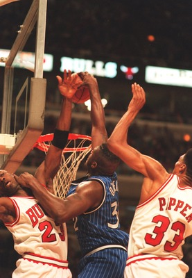 18 MAY 1995:  ORLANDO CENTER SHAQUILLE O'NEAL DUNKS OVER CHICAGO GUARD MICHAEL JORDAN AND PAST FORWARD SCOTTIE PIPPEN DURING THE MAGIC'S 108-102 VICTORY OVER THE BULLS IN THE SECOND ROUND OF THE NBA PLAYOFFS AT THE UNITED CENTER IN CHICAGO, ILLINOIS. Mand