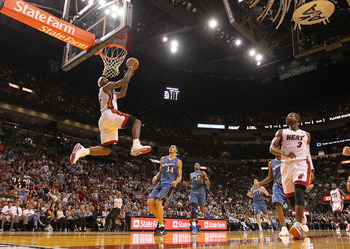 MIAMI, FL - NOVEMBER 29:  LeBron James #6 of the Miami Heat dunks during a game against the Washington Wizards at American Airlines Arena on November 29, 2010 in Miami, Florida. NOTE TO USER: User expressly acknowledges and agrees that, by downloading and