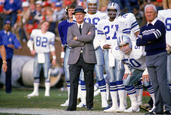 1988:  Head coach Tom Landry of the Dallas Cowboys watches from the sideline during a game in the 1988 season.  Tom Landry coached the Cowboys from 1960 to 1988, leading them to two Super Bowl victories.  (Photo by Otto Greule Jr./Getty Images)