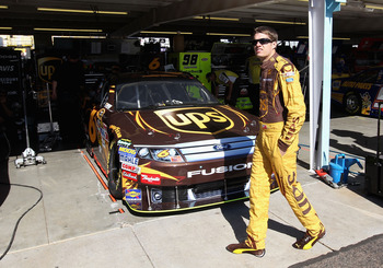 AVONDALE, AZ - NOVEMBER 12:  David Ragan, driver of the #6 UPS Ford, walks in the garage area during practice for the NASCAR Sprint Cup Series Kobalt Tools 500 at Phoenix International Raceway on November 12, 2010 in Avondale, Arizona.  (Photo by Christia