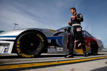 HOMESTEAD, FL - NOVEMBER 19:  Scott Speed, driver of the #82 Red Bull Toyota, walks by his car during qualifying for the NASCAR Sprint Cup Series Ford 400 at Homestead-Miami Speedway on November 19, 2010 in Homestead, Florida.  (Photo by Chris Graythen/Ge
