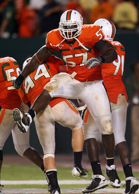 FORT LAUDERDALE, FL - SEPTEMBER 17:  Defensive lineman Allen Bailey #57 and linebacker Colin McCarthy #44 of the Miami Hurricanes celebrate after scoring a safety against the Georgia Tech Yellow Jackets at Land Shark Stadium on September 17, 2009 in Fort