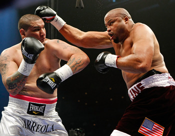 LAS VEGAS - APRIL 11:  Chris Arreola (L) and Jameel McCline trade blows in the first round of their heavyweight bout at the Mandalay Bay Events Center April 11, 2009 in Las Vegas, Nevada. Arreola won by knockout in the fourth round.  (Photo by Ethan Mille