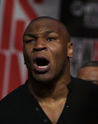 22 Jan 2002:  Mike Tyson is cut on his head and screams out a verbal tirade after brawling with Lennox Lewis at their press conference at the Millenium Hotel in New York City leading up to their fight in April at the MGM Grand in Las Vegas. Mandatory Cred