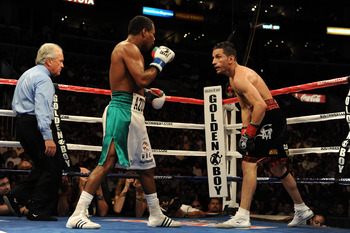 LOS ANGELES, CA - SEPTEMBER 18: (Left)  Shane Mosley and Sergio Mora fight to a draw during the sixth round of the Middleweight bout at Staples Center on September 18, 2010 in Los Angeles, California.  (Photo by Harry How/Getty Images)