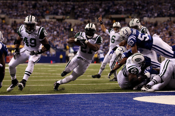 INDIANAPOLIS, IN - JANUARY 08:  LaDainian Tomlinson #21 of the New York Jets scores 1-yard rushing touchdown in the fourth quarter as quarterback Mark Sanchez celebrates in the background against the Indianapolis Colts during their 2011 AFC wild card play