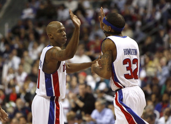 AUBURN HILLS, MI - APRIL 29:  Chauncey Billups #1 of the Detroit Pistons high fives Richard Hamilton #32 after his third quarter basket while playing the Philadelphia 76ers in Game Five of the Eastern Conference Quarterfinals during the 2008 NBA Playoffs