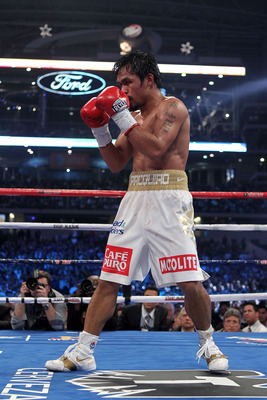 ARLINGTON, TX - NOVEMBER 13:  Manny Pacquiao (white trunks) of the Philippines fights against Antonio Margarito of Mexico during their WBC World Super Welterweight Title bout at Cowboys Stadium on November 13, 2010 in Arlington, Texas.  (Photo by Nick Lah