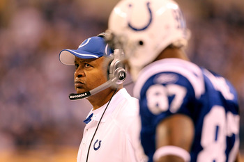 INDIANAPOLIS, IN - JANUARY 08:  (L-R) Head coach Jim Caldwell and Reggie Wayne #87 of the Indianapolis Colts looks on against the New York Jets during their 2011 AFC wild card playoff game at Lucas Oil Stadium on January 8, 2011 in Indianapolis, Indiana.
