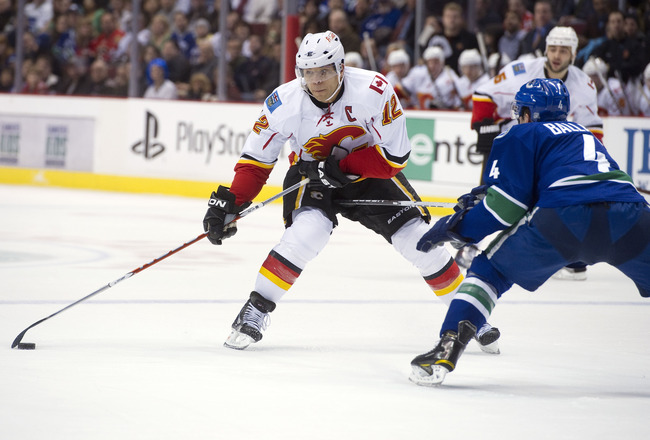 VANCOUVER, CANADA - JANUARY 5: Jarome Iginla #12 of the Calgary Flames tries to get past Keith Ballard #4 of the Vancouver Canucks with a toe drag move during the first period in NHL action on January 05, 2011 at Rogers Arena in Vancouver, BC, Canada.  (P