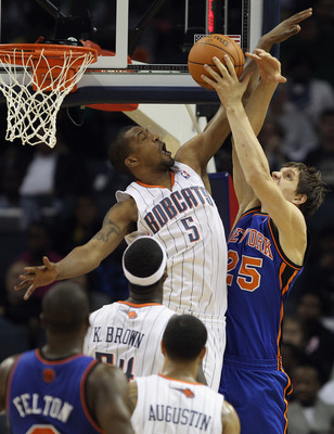 CHARLOTTE, NC - NOVEMBER 24:  Timofey Mozgov #25 of the New York Knicks has his shot blocked by Dominic McGuire #5 of the Charlotte Bobcats during their game at Time Warner Cable Arena on November 24, 2010 in Charlotte, North Carolina.  NOTE TO USER: User