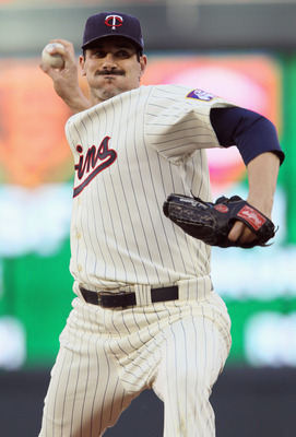 MINNEAPOLIS - OCTOBER 07:  Carl Pavano #48 of the Minnesota Twins delivers a pitch in the first inning against the New York Yankees during game two of the ALDS on October 7, 2010 at Target Field in Minneapolis, Minnesota.  (Photo by Elsa/Getty Images)