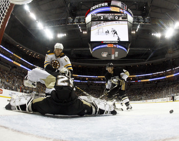 PITTSBURGH, PA - JANUARY 10:  Marc-Andre Fleury #29 of the Pittsburgh Penguins makes a save on Milan Lucic #17 of the Boston Bruins on January 10, 2011 at Consol Energy Center in Pittsburgh, Pennsylvania.  The Bruins defeated the Penguins 4-2.  (Photo by