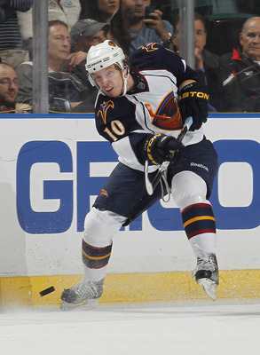 SUNRISE, FL - JANUARY 5: Bryan Little #10 of the Atlanta Thrashers shoots the puck at the Florida Panthers on January 5, 2011 at the BankAtlantic Center in Sunrise, Florida. The Thrashers defeated the Panthers 3-2. (Photo by Joel Auerbach/Getty Images)