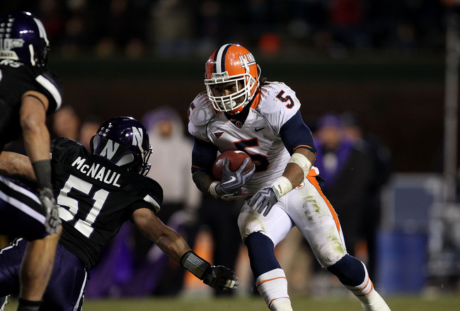 CHICAGO - NOVEMBER 20: Mikel Leshoure #5 of the Illinois Fighting Illini runs past Bryce McNaul #51 of the Northwestern Wildcats on his way to a 339 yard rushing performance during a game played at Wrigley Field on November 20, 2010 in Chicago, Illinois.