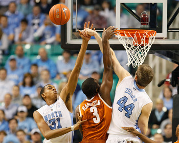 GREENSBORO, NC - DECEMBER 18:  Tyler Zeller #44 and John Henson #31 of the North Carolina Tar Heels block a shot by Jordan Hamilton #3 of the Texas Longhorns at Greensboro Coliseum on December 18, 2010 in Greensboro, North Carolina.  (Photo by Kevin C. Co
