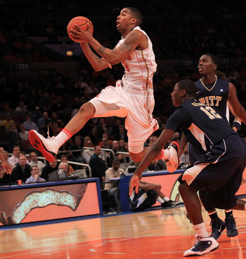 NEW YORK - NOVEMBER 18: Cliff Tucker #24 of the Maryland Terrapins drives past Ashton Gibbs #12 of the Pittsburgh Panther during the 2k Sports Classic at Madison Square Garden on November 18, 2010 in New York, New York.  (Photo by Chris McGrath/Getty Imag