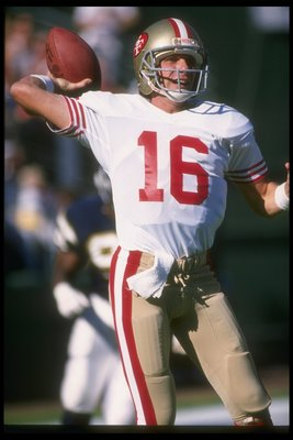 27 Nov 1988: Quarterback Joe Montana of the San Francisco 49ers looks to pass the ball during a game against the San Diego Chargers at Jack Murphy Stadium in San Diego, California. The 49ers won the game, 48-10.