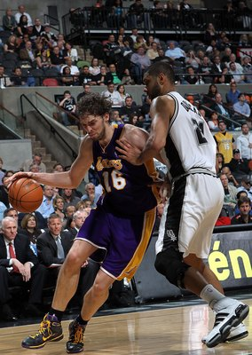 SAN ANTONIO - MARCH 24:  Forward Pau Gasol #16 of the Los Angeles Lakers dribbles the ball past Tim Duncan #21 of the San Antonio Spurs at AT&T Center on March 24, 2010 in San Antonio, Texas.  NOTE TO USER: User expressly acknowledges and agrees that, by
