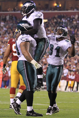 LANDOVER, MD - NOVEMBER 15:  Michael Vick #7 of the Philadelphia Eagles is congratulated by team mate Nick Cole #59 and Jason Avant #81 after scoring a touchdown against the Washington Redskins on November 15, 2010 at FedExField in Landover, Maryland.  (P