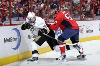WASHINGTON, DC - DECEMBER 23:  Mike Green #52 of the Washington Capitals battles for the puck against Evgeni Malkin #71 of the Pittsburgh Penguins at the Verizon Center on December 23, 2010 in Washington DC.  (Photo by Greg Fiume/Getty Images)