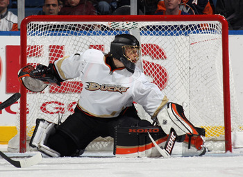 UNIONDALE, NY - DECEMBER 16: Jonas Hiller #1 of the Anaheim Ducks skates against the New York Islanders at the Nassau Coliseum on December 16, 2010 in Uniondale, New York.  (Photo by Bruce Bennett/Getty Images)