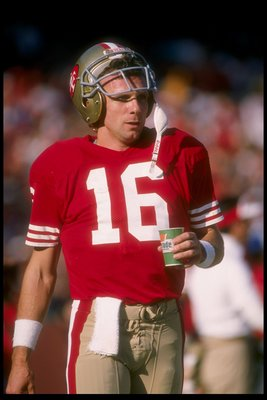 11 Dec 1988:  Quarterback Joe Montana of the San Francisco 49ers looks on during a game against the New Orleans Saints at Candlestick Park in San Francisco, California.  The 49ers won the game, 30-17. Mandatory Credit: Otto Greule  /Allsport