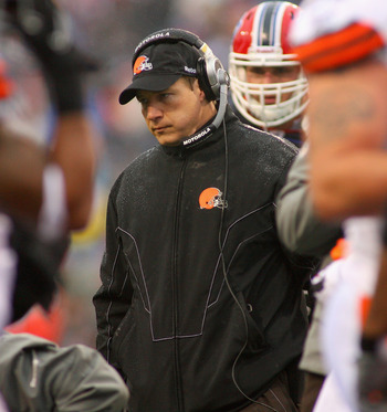 ORCHARD PARK, NY - DECEMBER 12: Eric Mangini, head coach of the Cleveland Browns stands over injured Browns player David Bowens #86 during a timeout against the Buffalo Bills at Ralph Wilson Stadium on December 12, 2010 in Orchard Park, New York.  (Photo