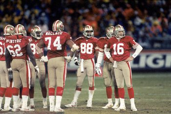 SAN FRANCISCO - DECEMBER 28:  Quarterback Joe Montana #16 of the San Francisco 49ers looks to the sidelines as he stands in the team huddle during the game against the Detroit Lions at Candlestick Park on December 28, 1992 in San Francisco, California.  T