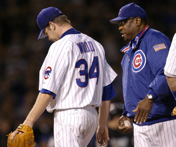 CHICAGO - OCTOBER 15:  Starting pitcher Kerry Wood #34 of the Chicago Cubs is relived by manager Dusty Baker in the sixth inning against the Florida Marlins during game seven of the National League Championship Series October 15, 2003 at Wrigley Field in