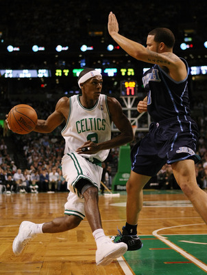 BOSTON - DECEMBER 15: Rajon Rondo #9 of the Boston Celtics heads for the net as Deron Williams #8 of the Utah Jazz defends on December 15, 2008 at TD Banknorth Garden in Boston, Massachusetts. The Celtics defeated the Jazz 100-91. NOTE TO USER: User expre