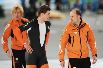 VANCOUVER, BC - FEBRUARY 26:  Sven Kramer of team Netherlands is consoled by coach Gerard Kemkers (R) in the Men's Team Pursuit Speed Skating Semi-Finals on day 15 of the 2010 Vancouver Winter Olympics at Richmond Olympic Oval on February 26, 2010 in Vanc