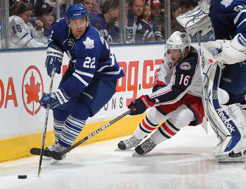 TORONTO, CANADA - DECEMBER 30:  Francois Beauchemin #22 of the Toronto Maple Leafs tries to elude the checking of Derek Brassard #16 of the Columbus Blue Jackets in a game on December 30, 2010 at the Air Canada Centre in Toronto, Canada. The Blue Jackets