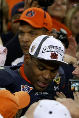 GLENDALE, AZ - JANUARY 10:  Quarterback Cameron Newton #2 of the Auburn Tigers celebrates as his father Cecil Newton is behind him after the Tigers 22-19 victory against the Oregon Ducks in the Tostitos BCS National Championship Game at University of Phoe